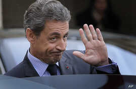 """FILE - Nicolas Sarkozy, former French president and head of the conservative """"Les Republicains"""" party, is seen leaving after a meeting with French President Francois Hollande at the Elysee Palace, in Paris, Jan. 22, 2016."""