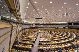 FILE - Members of the European Parliament attend a plenary session at the European Parliament in Brussels, Feb. 25, 2015. In a world of rising populism and fake news, the European Parliament is taking unusual steps to sweep clean hate speech in its o