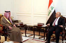 A handout picture released by the Iraqi Prime Minister's press office on February 25, 2017, shows Iraqi Prime Minister Haidar al-Abadi (R) meeting with Saudi Foreign Minister Adel al-Jubeir in Baghdad.