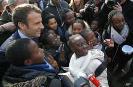 Independent centrist presidential candidate Emmanuel Macron poses with students of the Moliere school for a group photo in Les Mureaux, west of Paris, France, March 7, 2017.