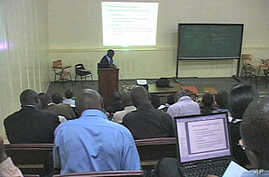 A tutor helps a class at the Kakuma Distance Learning Center in northern Kenya, Aug 2010