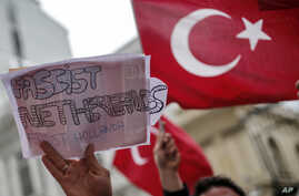 A group of Turks protest outside the Dutch consulate in Istanbul, Sunday, March 12, 2017.