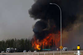 A wildfire burns near Highway 63 south of Fort McMurray, Alberta, Canada, May 6, 2016.
