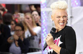 """This image released by Starpix shows singer Pink performing during an appearance on the """"Today"""" show, Sept. 18, 2012 in New York. Pink was promoting her new album, """"The Truth About Love."""""""