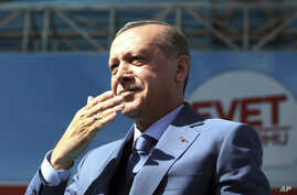 Turkey's President Recep Tayyip Erdogan gestures as he addresses his supporters during a referendum rally in Sanliurfa, Turkey, April 11, 2017.