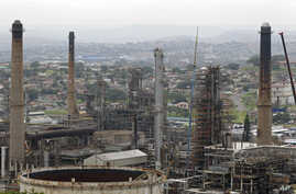 Chimneys from the Engen oil company are seen on the outskirts of the city of Durban, South Africa, the site of the COP17 climate talks, November 30, 2011.