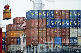 Container is loaded onto a cargo ship at the Tianjin port in China