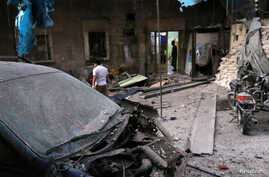 Medics inspect the damage outside a field hospital after an airstrike in the rebel-held al-Maadi neighbourhood of Aleppo, Syria, Sept. 28, 2016.