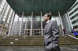 Attorney General Bob Ferguson stands on the steps of the federal courthouse as he waits to speak with media members after an immigration hearing there, March 15, 2017, in Seattle.