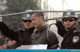 FILE - A death-sentenced criminal is taken on a truck to an execution ground in Zhuzhou, central China's Hunan province.