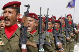 Soldiers march during their graduation ceremony at an Iraqi army base in Camp Taji in Baghdad, Feb. 21, 2016