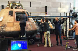 Scientists using special 3D technology to scan the interior of the Apollo 11 Command Module,  (National Air and Space Museum).