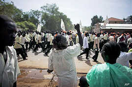 A southern Sudanese woman chants with pro-independence activists as they march through the southern capital of Juba, 09 Sep 2010