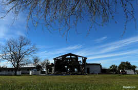 FILE PHOTO: The structure of a mosque is seen one day after a fire at the Victoria Islamic Center inn Victoria, Texas Jan. 29, 2017.