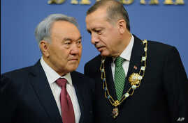 Turkey's Prime Minister Recep Tayyip Erdogan, right, and Kazakh President Nursultan Nazarbayev seen during a press conference in Ankara, Oct. 11, 2012.