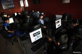 People use computers at an internet cafe in Ankara, Feb. 6, 2014.