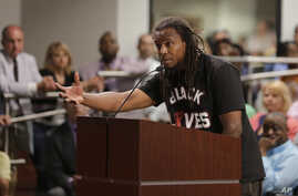 FILE - Muhiyidin d'Baha, whose legal name was Muhiyidin Elamin Moye, speaks during a meeting with North Charleston city council in North Charleston, S.C., April 9, 2015.