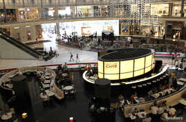 Customers dine at Dubai Mall in June 2012. A planned 'Mall of the World' there would be the largest to date.