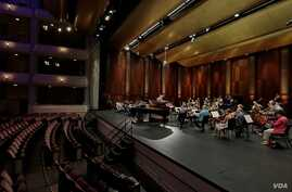 A rehearsal with conductor Nicholas McGegan and the Fort Worth Symphony Orchestra at The 15th Van Cliburn International Piano Competition