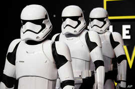 Actors dressed as Stormtroopers pose for photographers upon arrival at the European premiere of the film 'Star Wars: The Force Awakens ' in London, Dec. 16, 2015.