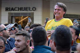 Brazilian presidential candidate Jair Bolsonaro reacts after being stabbed during a rally in Juiz de Fora, Minas Gerais state, Brazil, Sept. 6, 2018.