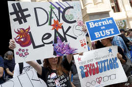 Demonstrators make their way around downtown, Monday, July 25, 2016, in Philadelphia, during the first day of the Democratic National Convention after some of the 19,000 emails, presumably stolen from the DNC by hackers, were posted to the website Wi...