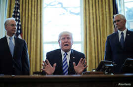 President Trump reacts to the pulling of the American Health Care Act by congressional Republicans before a vote as he appears with Secretary of Health and Human Services Tom Price (left) and Vice President Mike Pence (right) in the Oval Office of th...