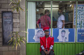 A security guard sits near a gate in Addis Ababa, Ethiopia Monday, Oct. 10, 2016