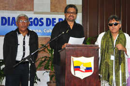 FILE - Ivan Marquez, chief negotiator for the Revolutionary Armed Forces of Colombia (FARC), center, accompanied by Jesus Santrich, right, and Joaquin Gomez, left, speaks at a news conference at the close of another round of peace talks with Colombia