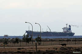 A North Korean-flagged tanker is docked at the Es Sider export terminal in Ras Lanuf, Libya, March 8, 2014.