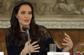 FILE - actress Angelina Jolie gives a press conference.