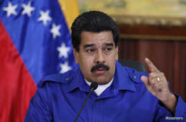 Venezuela's President Nicolas Maduro talks during a meeting with ministers at Miraflores Palace in Caracas, Sept. 3, 2014.