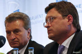 FILE - EU Energy Commissioner Guenther Oettinger (L) and Russian Energy Minister Alexander Novak are seen at a news conference in Berlin May 19, 2014.