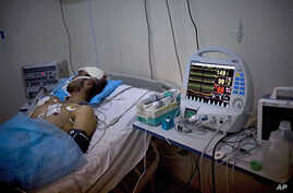 Injured Libyan lays in an intensive care until at Hikma hospital in the besieged city of Misrata, Libya, May 3, 2011