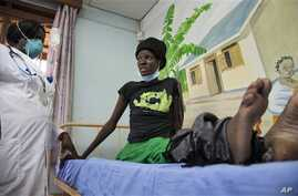 A newly-diagnosed HIV positive woman, who arrived at the hospital with symptoms of tuberculosis (TB), receives treatment at the Mildmay Uganda clinic, which receives funding from the US government through the Centers for Disease Control and Preventio