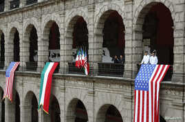U.S. and Mexican flags are displayed at the National Palace where U.S. President Barack Obama and his Mexican counterpart Enrique Pena Nieto were meeting, in Mexico City, May 2, 2013.