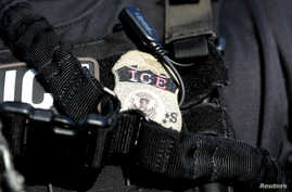FILE - A U.S. Immigration and Customs Enforcement badge.