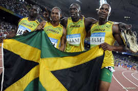 FILE: Men's 4x100m relay Asafa Powell, Usain Bolt, Michael Frater, Nesta Carter of Jamaica celebrate after winning the final of the athletics competition in the National Stadium during the Beijing 2008 Olympic Games Aug. 22, 2008.