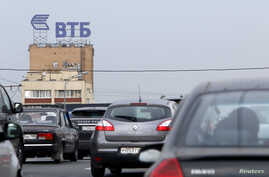 A sign showing the logo of Russia's VTB Bank is seen along a road in Moscow July 17, 2014.