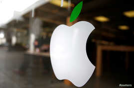 FILE - The logo of Apple (AAPL) is seen in Los Angeles, California, United States, April 22, 2016.