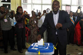 FILE - Congolese president Joseph Kabila casts his ballot in the country's presidential election at a polling station in Kinshasa, Democratic Republic of Congo, Nov. 28, 2011..