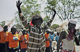 A southern Sudanese man dons traditional tribal accessories during a pro-independence march in the southern capital of Juba, 09 Sept. 2010