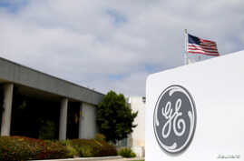 FILE - The logo of Dow Jones Industrial Average stock market index listed company General Electric is shown at their subsidiary company GE Aviation in Santa Ana, California, Apr. 13, 2016.