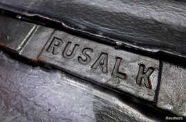 FILE - Aluminum ingots are seen stored at the foundry shop of the Rusal Krasnoyarsk aluminum smelter in the Siberian city of Krasnoyarsk, Russia.
