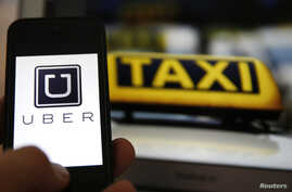 An illustration picture shows the logo of car-sharing service app Uber on a smartphone next to the picture of an official German taxi sign in Frankfurt, September 15, 2014. A Frankfurt high court will hold a hearing on a recent lawsuit brought agains