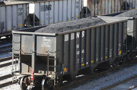 FILE - Coal cars fill a rail yard in Williamson , W.Va., Nov. 11, 2016. The hard-eyed view along the Tug Fork River in coal country is that Donald Trump has to prove he'll help Appalachian mining like he promised.