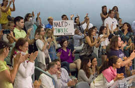 Demonstrators cheer at a city commission meeting in Miami Beach, Florida, Sept. 14, 2016. Opponents want to stop the aerial spraying of the insecticide naled, used to combat the Aedes aegypti mosquito.