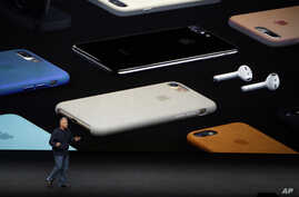 Phil Schiller, Apple's senior vice president of worldwide marketing, talks about the pricing on the new iPhone 7 during an event to announce new products in San Francisco, Sept. 7, 2016.