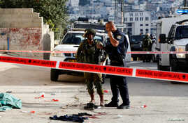 Israeli security forces stand at the scene of what the Israeli military said was a stabbing attack by a Palestinian, in Tal-Rumida in the West Bank city of Hebron September 17, 2016