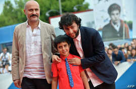 "Turkish director Kaan Mujdeci (R), actor Dogan Izci (C) and actor Muttalip Mujdeci arrive for the screening of the movie ""Sivas"" presented in competition at the 71st Venice Film Festival on Sept. 3, 2014 at Venice Lido."